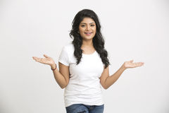 Gesturing happy pretty Indian young woman Royalty Free Stock Photos