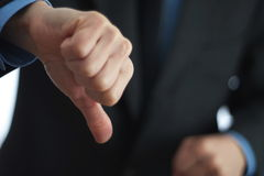 Gesturing thumbs down sign Royalty Free Stock Photography