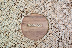 Gesund, German text for Healthy, word in letters on cube dices on table stock image