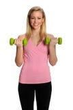 Gesunde junge Frau Excercising mit Gewichten Stockfoto