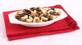 Gesunde Lebensmittel-Mandeln, Acajounüsse und Rosinen Stockfotografie