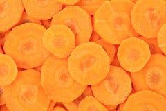 Gesunde natürliche Nahrung, Hintergrund. Karottescheiben. Stockbild