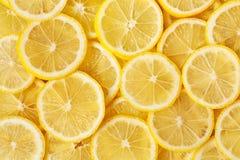 Gesunder Nahrungsmittelhintergrund. Zitrone. Stockbild