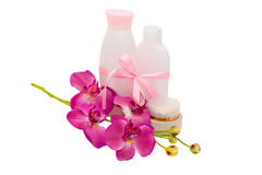 Gesundes Geschenk: Kosmetik mit Blumenorchidee, Isolator Stockfotografie