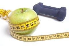 Gesundes Lebenkonzept - Nahrung und Trainieren Stockfotos