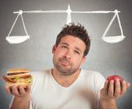 Gesundes Lebensmittel und ungesund Stockfotos