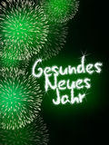 Gesundes Neues Jahr German Happy New Year. Colorful impressive fireworks happy new year celebration green Stock Photography