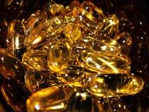 Gesundheit ergänzt Fisch-Öl Softgels-Stapel-Hintergrund Lizenzfreie Stockbilder