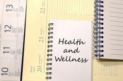 Gesundheit und Wellness schreiben auf Notizbuch Lizenzfreie Stockbilder