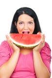 Gesundheitsfrau, die Wassermelone isst Stockbilder