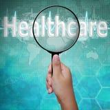 Gesundheitspflege, Wort im Vergrößerungsglas Lizenzfreie Stockbilder