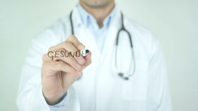 Gesundheitswesen, Healthcare in German Writing on Glass. Man writing stock video