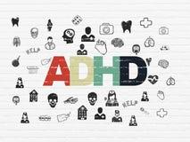 Gesundheitswesenkonzept: ADHD auf Wandhintergrund Lizenzfreie Stockfotos