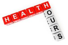 Gesundheitswesenkonzept. Würfel mit Gesundheitsstundenzeichen Stockfotografie
