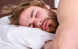 Get adequate and consistent amount of sleep every night. Expert tips on sleeping better. Bearded man sleeping face. Relaxing on pillow. How much sleep you royalty free stock photo