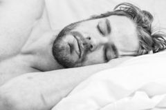 Get adequate and consistent amount of sleep every night. How much sleep you actually need. Bearded man sleeping face. Relaxing on pillow. Expert tips on stock photos