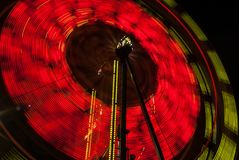 Amusement Ride. Get an adrenaline rush from going on this spinning amusement ride with your family stock images
