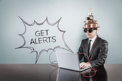 Get alerts text with vintage businessman using laptop. At office royalty free stock photography