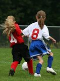Get That Ball. Youth girls playing soccer - fighting for the ball Stock Photo