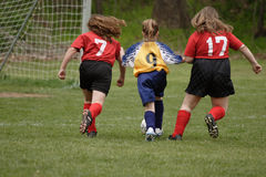 Get That Ball 3. Girl chasing soccer ball down the field Stock Photo
