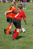 Get That Ball 4. Girl chasing soccer ball down the field Stock Image