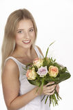 She get a bouquet of flowers (roses) for her birthday Royalty Free Stock Photography
