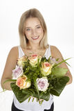 She get a bouquet of flowers (roses) for her birthday Royalty Free Stock Image