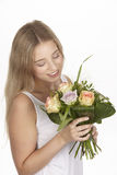 She get a bouquet of flowers (roses) for her birthday Stock Images