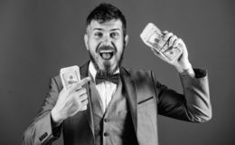 Get cash easy and quickly. Cash transaction business. Man happy winner rich hold pile of dollar banknotes blue. Background. Easy cash loans. Win lottery concept stock photo