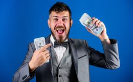Get cash easy and quickly. Cash transaction business. Man happy winner rich hold pile of dollar banknotes blue. Background. Easy cash loans. Win lottery concept stock image
