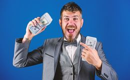 Get cash easy and quickly. Cash transaction business. Man happy winner rich hold pile of dollar banknotes blue. Background. Easy cash loans. Win lottery concept stock photos