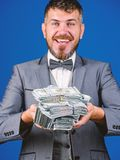 Get cash easy and quickly. Cash transaction business. Man happy winner rich hold pile of dollar banknotes blue. Background. Win lottery concept. Easy cash loans royalty free stock photos
