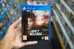 Get Even. Bratislava, Slovakia, June 1, 2017: Man holding Get Even videogame on Sony Playstation 4 console in store Stock Images