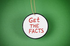 Get the facts. Green background. Vignette royalty free stock photography