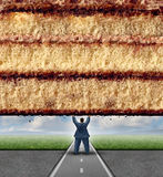 Get Fit. Concept and losing weight fitness and health care metaphor as an overweight man lifting a wall made of cake as a symbol of overcoming dieting Royalty Free Stock Image