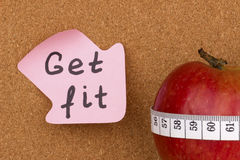 Get Fit written on sticky note and apple Royalty Free Stock Image