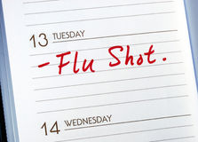 Get a Flu Shot. Mark the date on the day planner to have a flu shot Stock Images