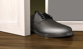 Get A Foot In THe Door. A literal depiction of the saying get a foot in the door Stock Photos