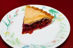 Serving up the traditional holiday cherry pie Royalty Free Stock Images