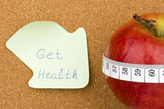 Get Health тwritten on sticky note and apple Royalty Free Stock Photo