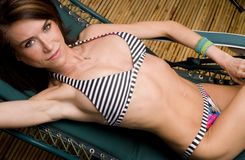 Woman Lying Lounge Chair Sunbathing Bamboo Stock Photography