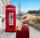 Get a hotel in london. Guest holding the hotel room key at London with Big Ben in the background Royalty Free Stock Image