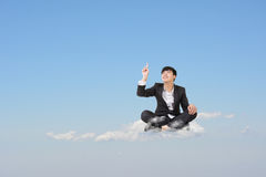 Get an idea. Asian business man sit on cloud over sky and get an idea, cloud concept for business, creative, technology, social network etc Royalty Free Stock Photo