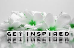 Get inspired green theme. Get inspired text message with green theme and flowers Stock Photos