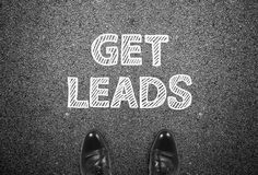 Get leads writing on ground. With businessman feet Stock Photo