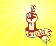 Get Lucky and Stay Optimistic: cool tattoo design of hand with crossed fingers Royalty Free Stock Photography