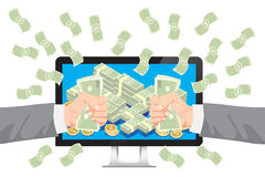 Get money from online business holding dollar in hand  with falling money  Royalty Free Stock Photos