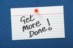 Get More Done!. A reminder on a notice board to Get More Done through time management and best practice to improve efficiency in Business and in life royalty free stock photos