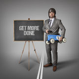 Get more done text on blackboard with businessman Royalty Free Stock Photos