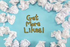 Get More Likes text with crumpled paper balls Royalty Free Stock Image